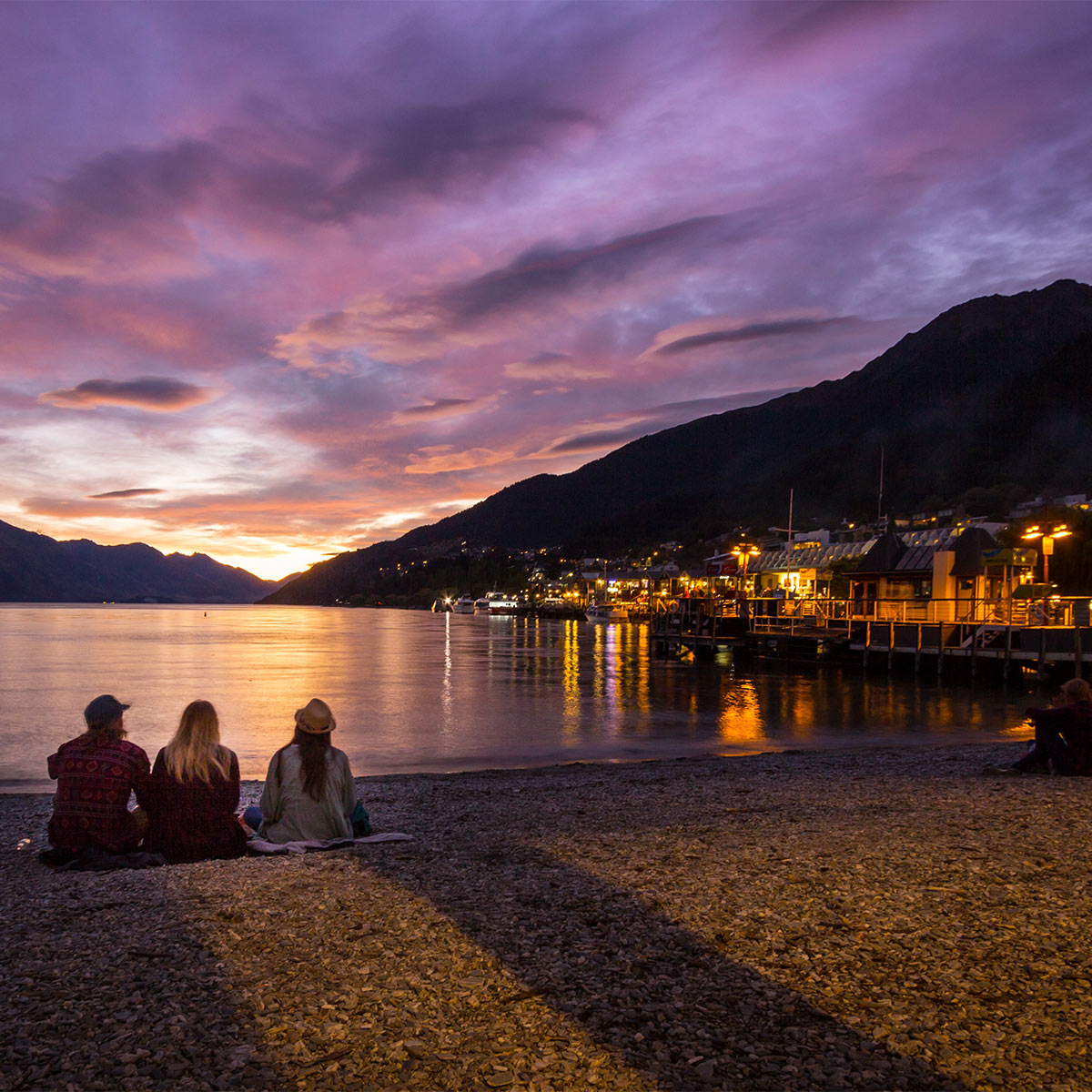 https://www.shimmerlake.co.nz/wp-content/uploads/2016/05/Watching-the-sunset-on-Queenstown-Bay.jpg